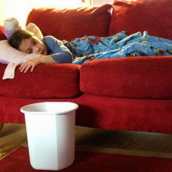Child on the couch with flu